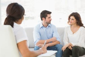 Couple getting counseling from therapist
