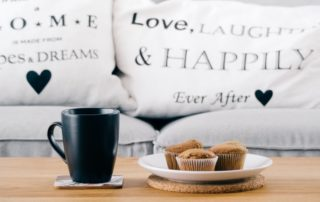Pillows with words Love, laugh and happily ever after